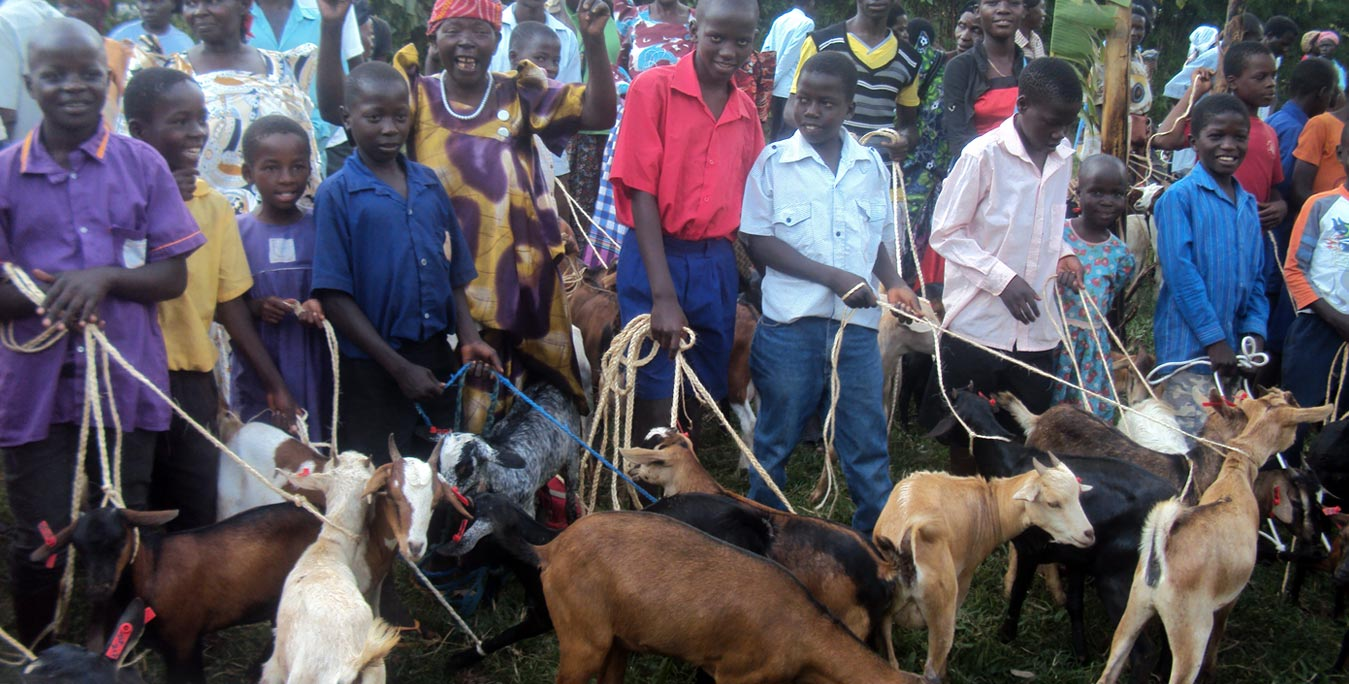Children and Parents receiving goats